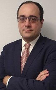 white man, glasses, dressed, dark suit, pink tie