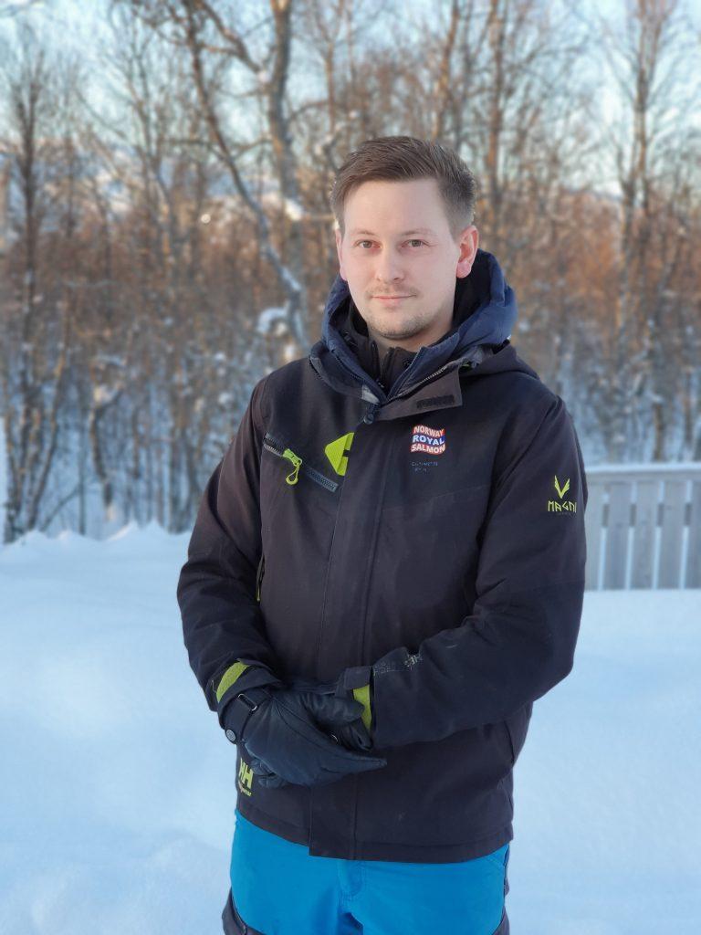 man standing snow extreme aquaculture