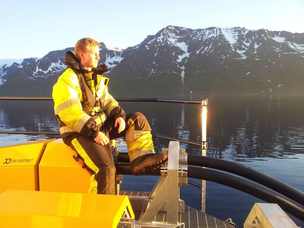 man contemplating nature fish cage fjord