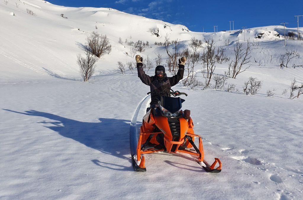 man snowmobile snow